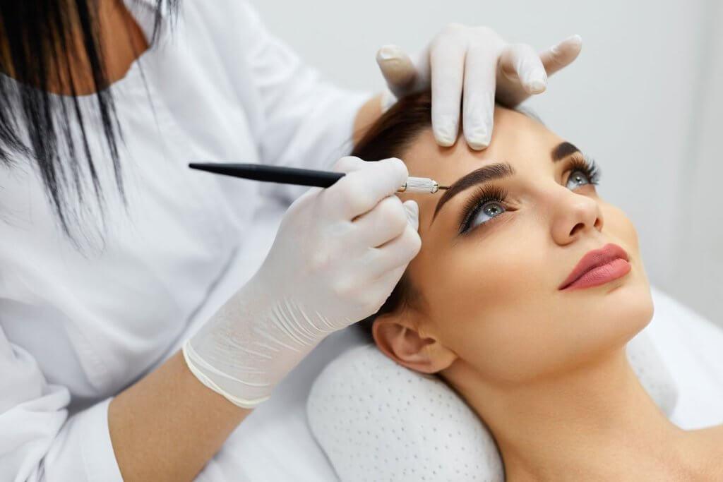 Women Receiving Microblading Treatment